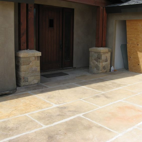 view of back of the house line of stamped concrete and stonework in goleta